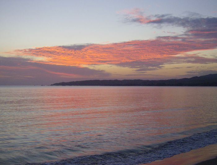Water Beauty In Nature Scenics - Nature Sky Sea Tranquil Scene Cloud - Sky Mountain No People Beach Idyllic Nature Orange Color Land Sunset Non-urban Scene Outdoors Tranquility Dramatic Sky