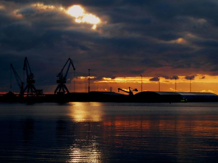 Sunset Water Cloud - Sky Sky Transportation Mode Of Transportation Nautical Vessel Sea Waterfront Freight Transportation Silhouette Shipping  No People Nature Reflection Business Orange Color Crane - Construction Machinery Beauty In Nature Outdoors Sailboat