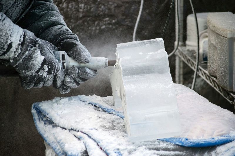 Cropped Image Of Craftsperson Shaping Ice During Winter