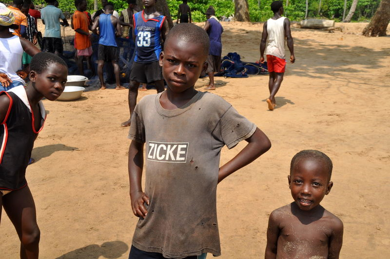 Funny Shirt Africa African Boy Boys Childhood Children Children Photography Daily Life Funny Faces German Word Ghana Ghanaian Heat Looking At Camera Outdoors Person Portrait Street Photography Sunny Day T-shirt The Week On Eyem Togetherness Village