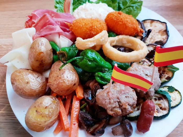 Plate full of Spanish Tapas for two. ... Tapas Spanish Food Spanish Plate Seafood Vegetable Close-up Food And Drink Temptation Serving Dish Served Unhealthy Lifestyle Appetizer Food Styling Prepared Food Serving Size Ready-to-eat Indulgence