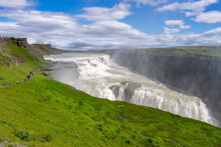 Water Scenics - Nature Waterfall Nature Landscape Outdoors Green Color Travel Destinations Travel Gullfoss Gullfoss Waterfall Iceland Golden Circle Scenics River Blue Sky Beauty In Nature Flowing Water Grass Tourism