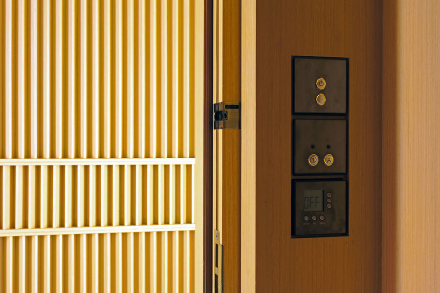 An interior of a fancy room Architecture Close-up Day Door Electric Button Indoors  Indoors  Interior Design Material No People Pattern Push Button Ring Safety Wood Paneling Yellow EyeEmNewHere
