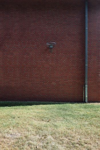 PLAYGROUND Basketball Basketball Hoop Architecture Brick Brick Wall Building Building Exterior Built Structure Day Door Grass Lighting Equipment Nature No People Outdoors Plant Protection Safety Security Technology Wall Wall - Building Feature The Still Life Photographer - 2018 EyeEm Awards The Architect - 2018 EyeEm Awards