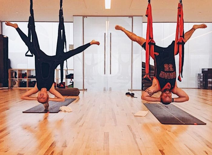 Couple doing aerial yoga together Exercising Healthy Lifestyle Two People Couple Exercising Exercising Together Couple Activities Couple Fitness Yoga Aerial Yoga Swing Yoga Workout Together
