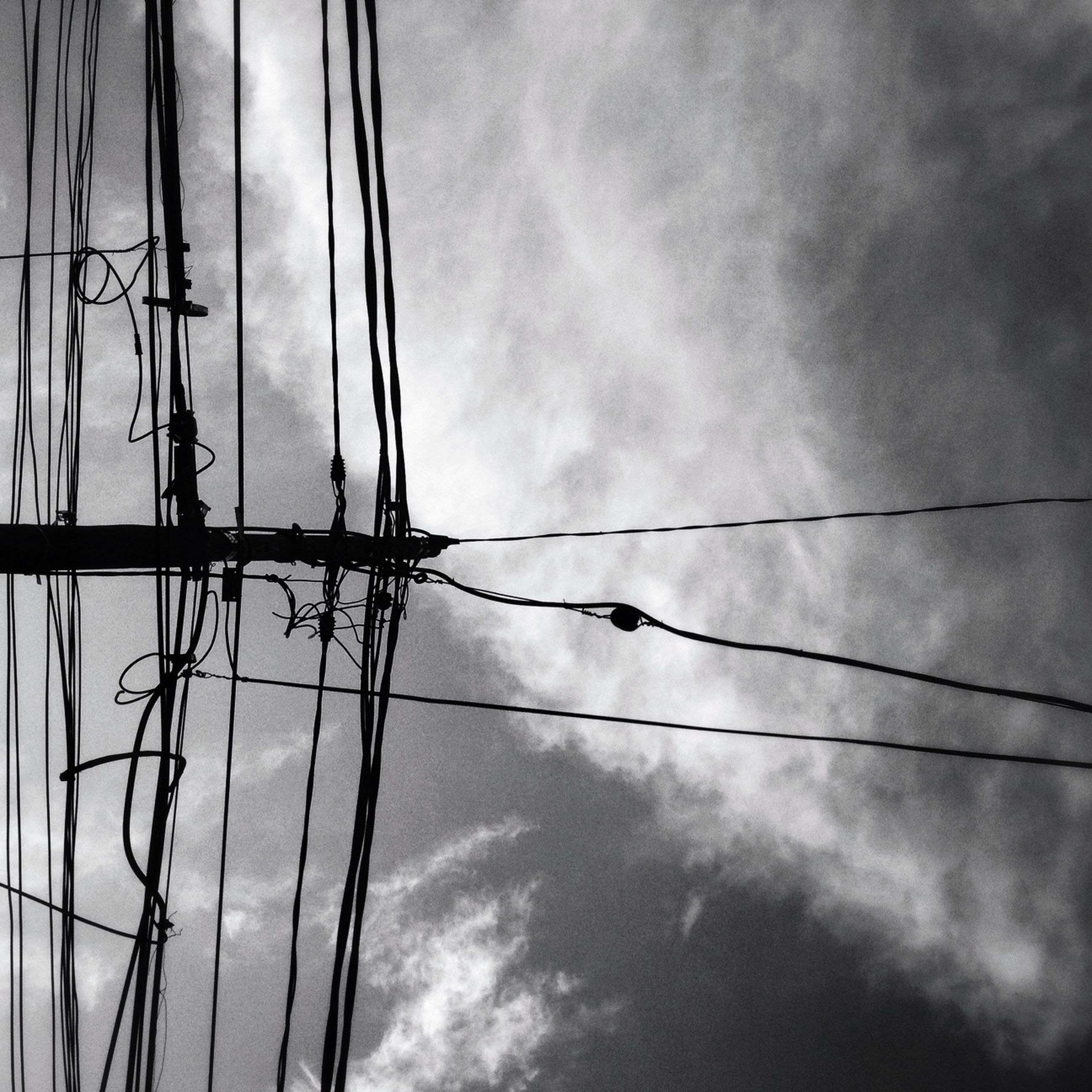 power line, low angle view, power supply, electricity, electricity pylon, cable, sky, connection, fuel and power generation, cloud - sky, technology, cloudy, power cable, cloud, silhouette, complexity, no people, outdoors, nature, pole