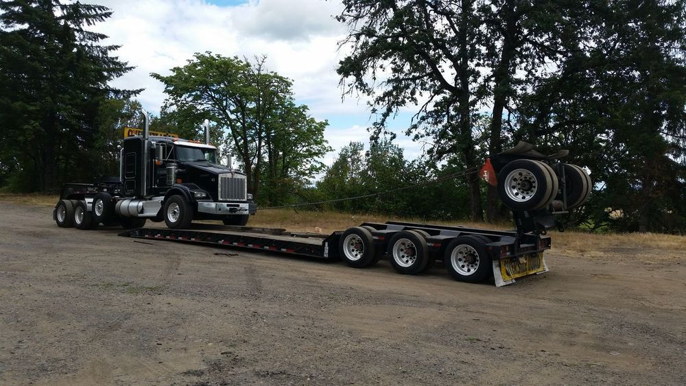 Flipping up the axle. Big Rig Land Vehicle Mode Of Transport On The Way Oregon Outdoors Parked Sky Stationary Tree Work