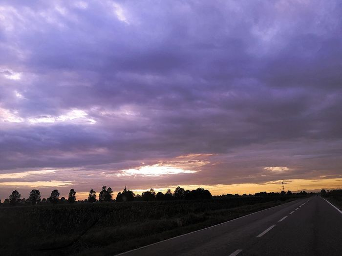 Panoramic view of road against sky during sunset