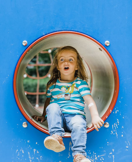 Girl looking away while playing in playground