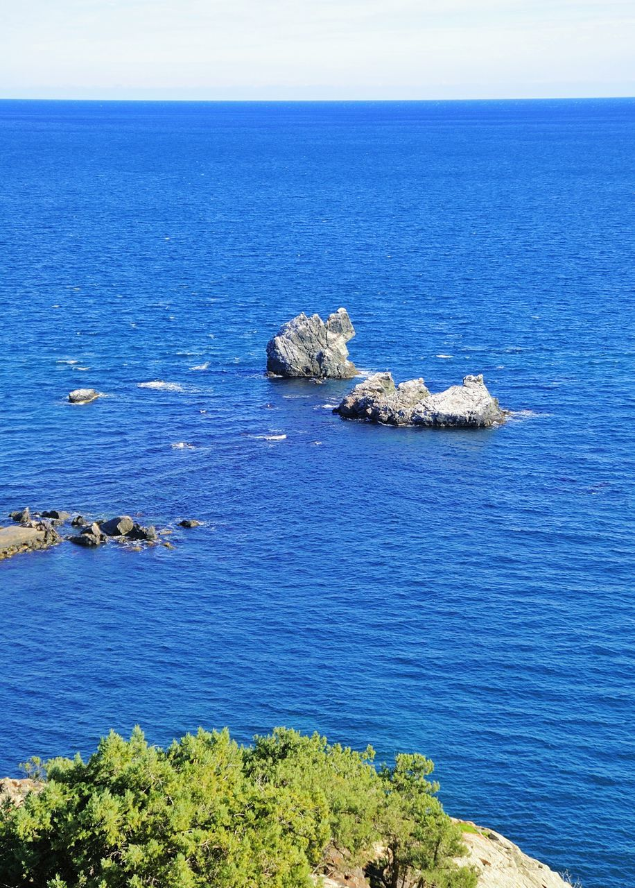 water, sea, beauty in nature, scenics - nature, horizon, horizon over water, tranquil scene, blue, tranquility, sky, no people, rock, nature, rock - object, idyllic, day, solid, land, non-urban scene