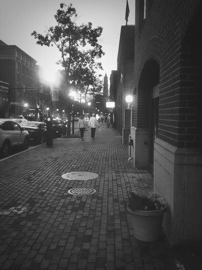 Some hand holding Walks in Ole Town Alexandria Night Lights Authentic Moments