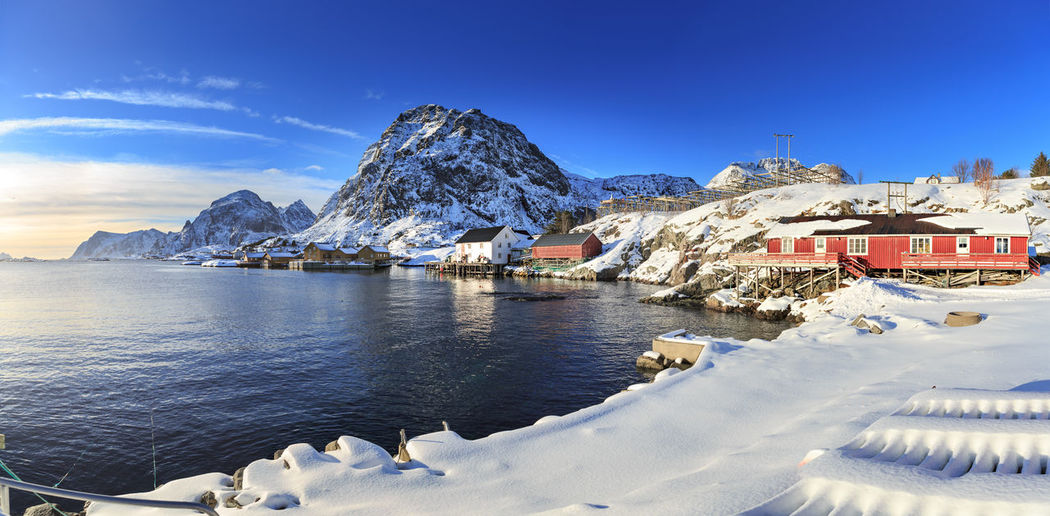Landscape of Lafoten Islands at winter Lofoten Islands Norway Winter Architecture Beauty In Nature Building Building Exterior Built Structure Cold Temperature Day House Landscape Mountain Mountain Range Nature Night No People North Northsea Outdoors Residential District Scenics - Nature Sky Snow Snowcapped Mountain Water Winter