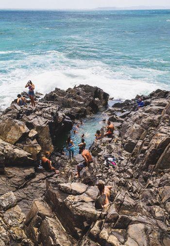 Rock pool on the edge of cliff. Sea Pool Real People Wave Horizon Over Water Water Outdoors People Beauty In Nature Eyeem Brisbane EyeEm Best Shots Beauty In Nature Coastline