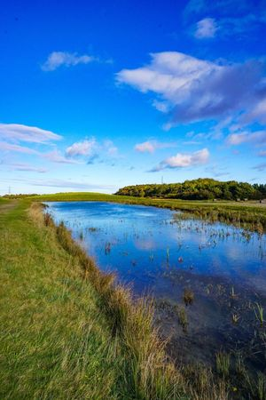 Perspectives On Nature Tranquil Scene Tranquility Grass Scenics Nature Water Beauty In Nature Landscape No People Sky Outdoors Lake Cloud - Sky Day Travel Destinations Vacations Blue Growth