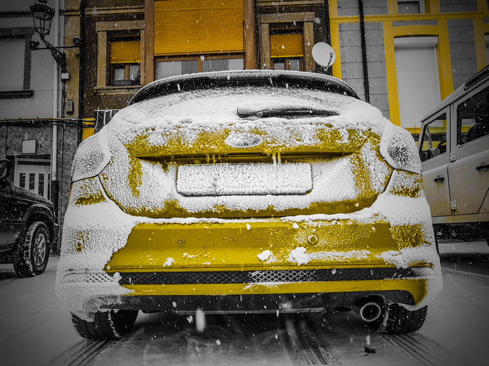 Close-up of yellow car on snow