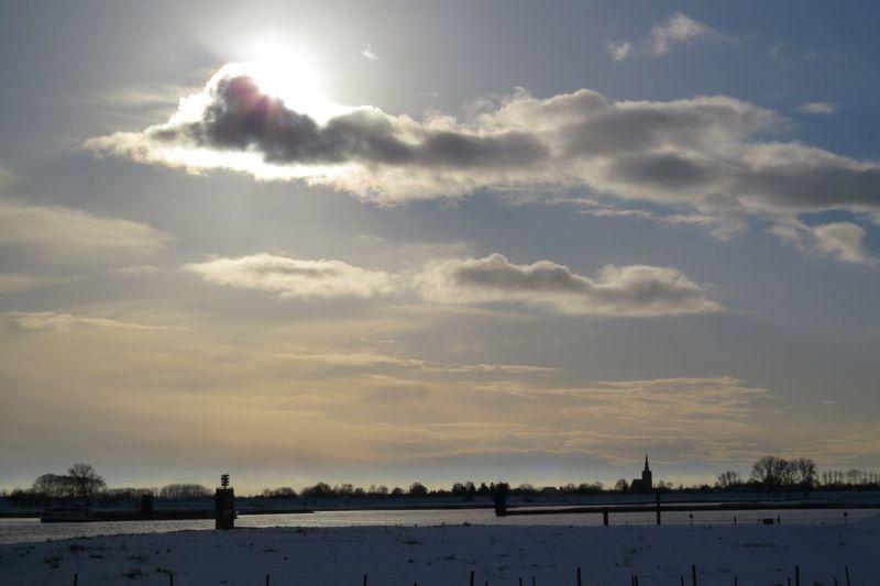 across the Rijn/Lek Ravenswaaij Wijkbijduurstede Lek Rijn Snow Church Church Hunter Scenic View Scenic Landscapes Snow Snowscape Clouds And Sky Sun Dijk
