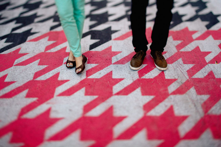 Casual Clothing Communication Couple Creativity Fashion Footwear Human Body Part Human Leg Ideas Low Section Multi Colored Pattern Pieces Red Shoe Standing Street Art Symbol Tiltshift Up Close Street Photography Feel The Journey