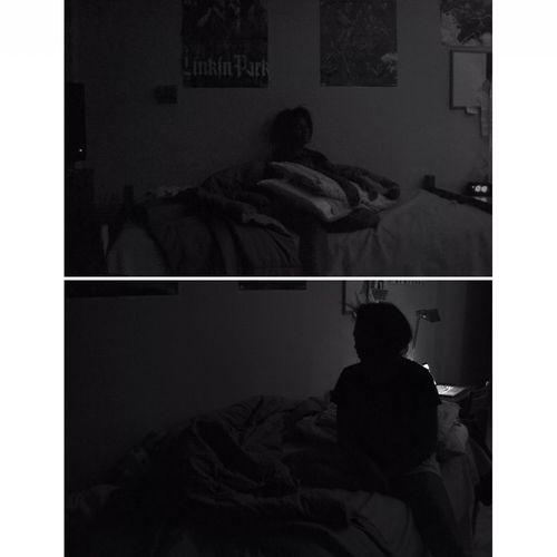 Rear view of silhouette woman sitting on bed