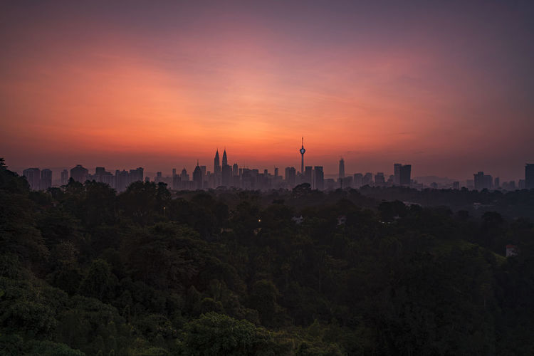 Silhouette of city during sunset