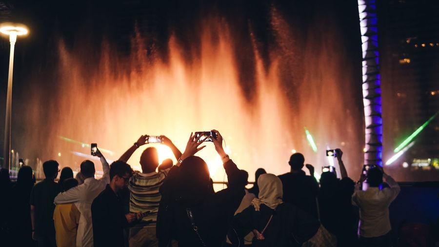 People enjoying music concert at night during jeddah season