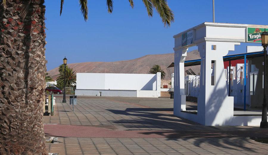 Fuertaventura Fuerteventura Fuerteventura Island Fuerteventura Landscape Architecture Blue Building Exterior Built Structure Clear Sky Day Fuerteventuraexperience Nature No People Outdoors Palm Tree Shadow Sky Sunlight Tree