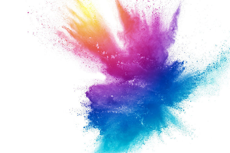 Defocused image of multi colored powder paints against white background