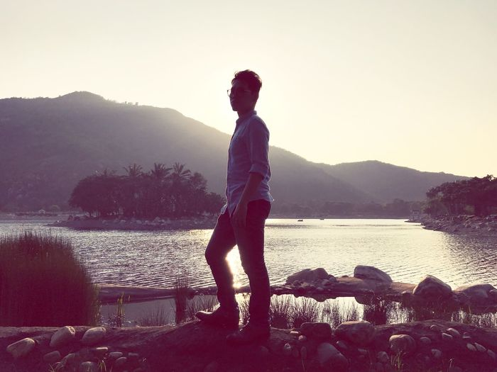 Mountain Water Real People Nature Standing Clear Sky Leisure Activity Beauty In Nature Lake Full Length Casual Clothing One Person Outdoors Scenics Young Adult Sunset Men Day Sky Asian  HongKong