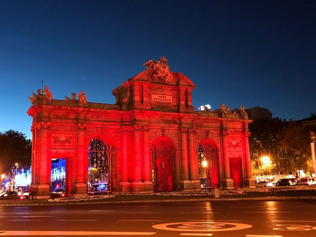 Architecture Illuminated Night Built Structure Red History Outdoors Low Angle View AIDSDay Blue Transportation City Puertadealcala Madrid Spain Triumphal Arch Clear Sky No People Sky