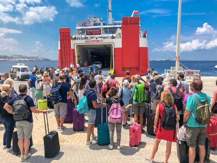 Summer tourists waiting to board the ferry from Mykonos to Naxos, Greece Aegean Sea Ferry Boat Ferry Boats Ferry Terminal Large Group Of People Sea Summer Travel Destinations