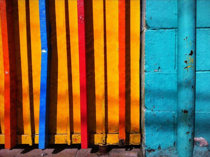 Street architectural detail in Mexico City, Mexico Architecture Backgrounds Blue Building Exterior Built Structure Close-up Day Full Frame Metal Multi Colored No People Orange Color Outdoors Pattern Side By Side Wall - Building Feature Wood - Material Yellow