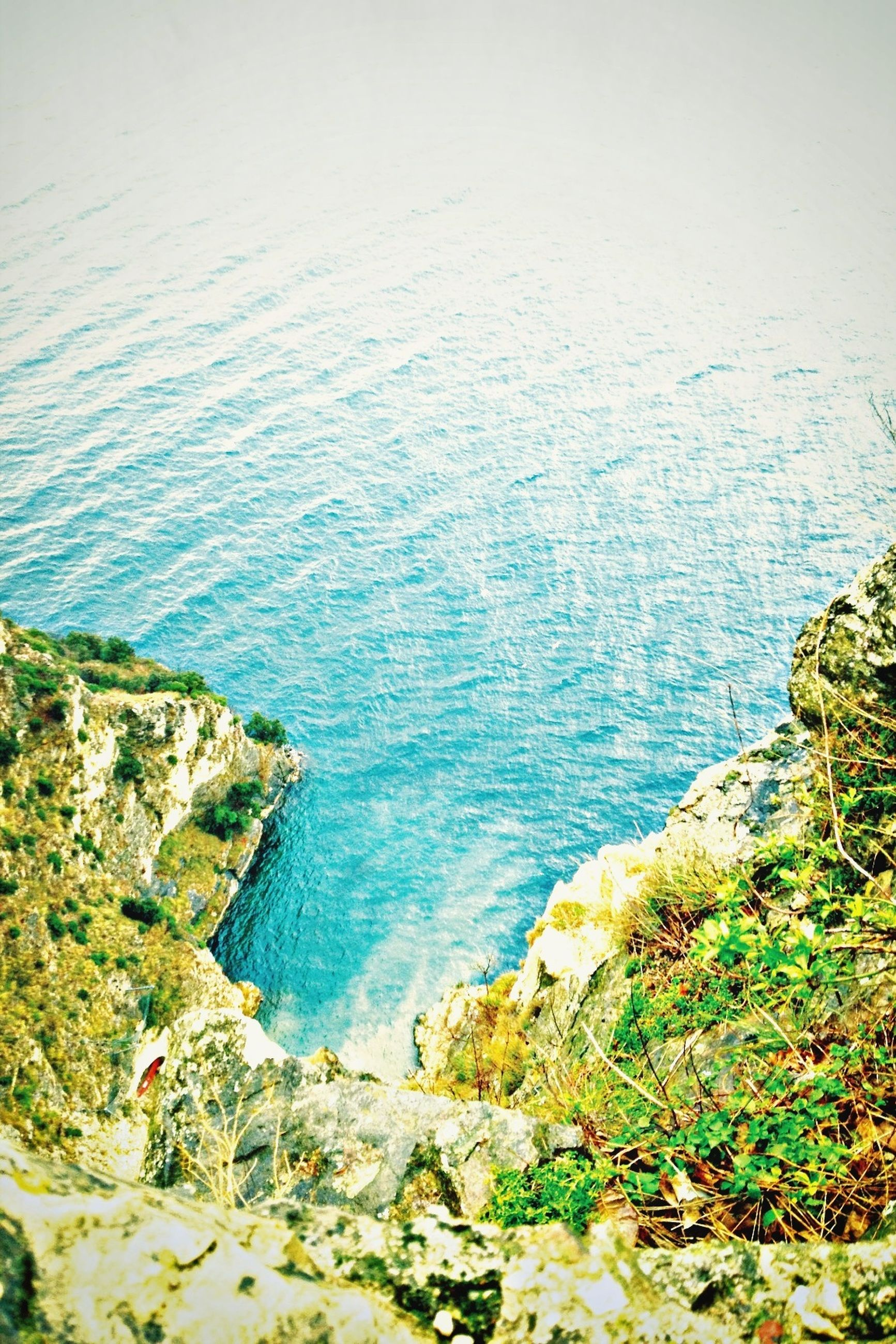 water, sea, scenics, tranquil scene, tranquility, beauty in nature, high angle view, nature, rock - object, horizon over water, idyllic, coastline, day, rock, rock formation, cliff, plant, blue, outdoors, non-urban scene