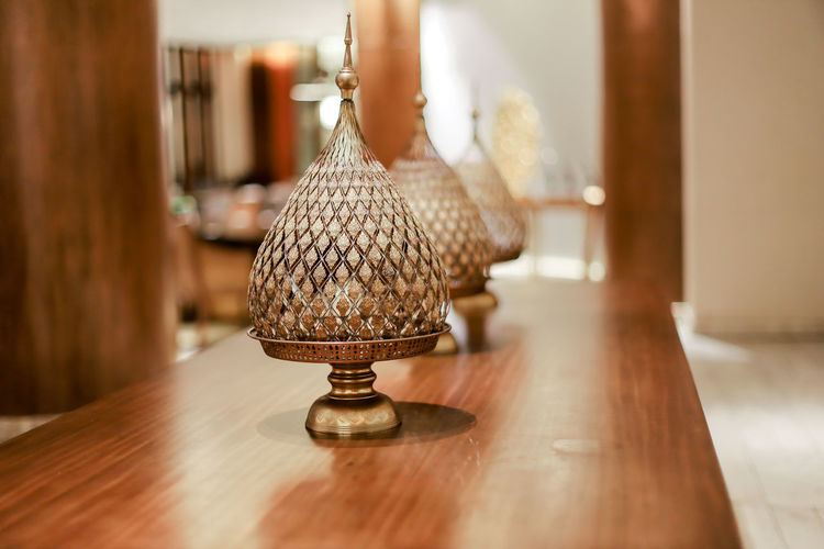 Close-up of electric lamp on table at home