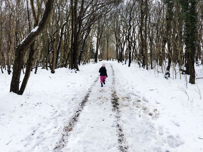 Wood Running Childhood Child Girl Fun Snow Cold Temperature Winter Real People Tree One Person Leisure Activity Nature Outdoors Day