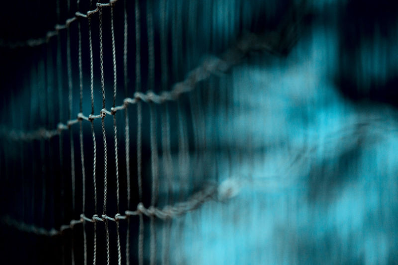 volleyball nets Alloy Backgrounds Barrier Boundary Business Close-up Connection Fence Hanging Indoors  Industry Metal Nets No People Pattern Protection Safety Security Selective Focus Sport Steel Technology Textile Thread Volleyball