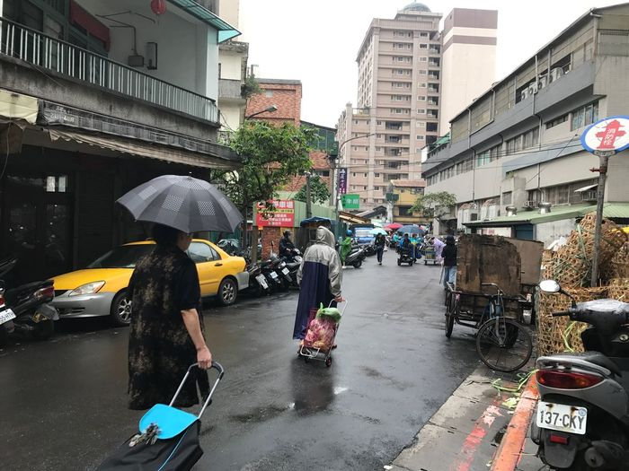 Architecture Building Exterior Built Structure Car City City Life Day Land Vehicle Large Group Of People Lifestyles Market Marketplace Outdoors People Real People Shopping At Market Sky Street Transportation Wet