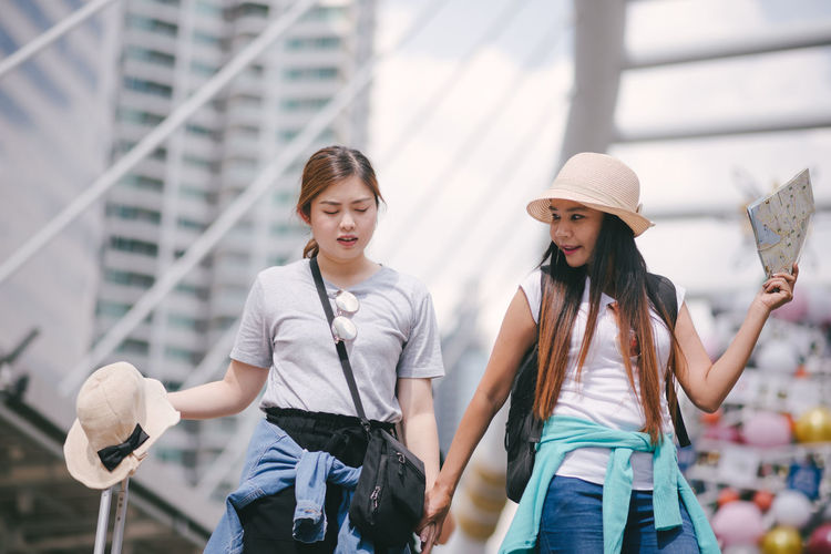 Tourists standing in city