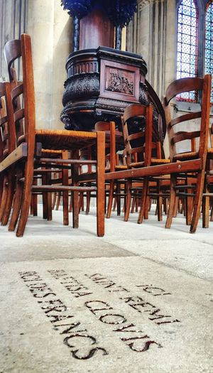 Clovis  Rheims Reims Cathedral Hanging Out Urbanphotography Hanging Out Urbanphotography The Past Absence Text History Old Building Built Structure Day No People Wood - Material Architecture Chair Seat