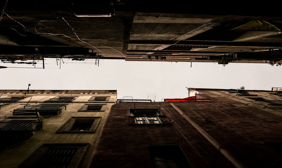 Even on a grey day, this city feels warm and colorful: Barcelona, Spain. Architecture Barcelona Catalunya Cloudy Cloudy Day Laundry Old Town SPAIN Travel Travel Photography Architecture Photography Built Structure Day Fujifilm Historic Looking Up Narrow Street No People Old Buildings Old House Sky Street Street Photography Streetphotography Windows