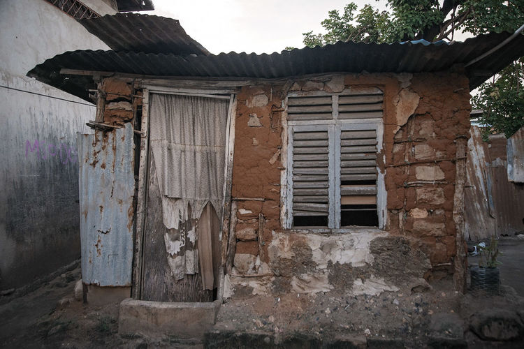 Doors, Gates and open Spaces Mud House Poverty Door Window Ruined Damaged House Weathered Rusty Poor  Poor Condition Unhealthy Lifestyle Unhealthy Unhealthy Living Third World Slum