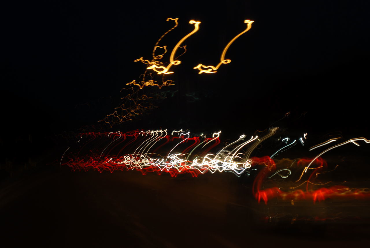 night, illuminated, long exposure, celebration, glowing, blurred motion, no people, speed, motion, red, outdoors, firework - man made object