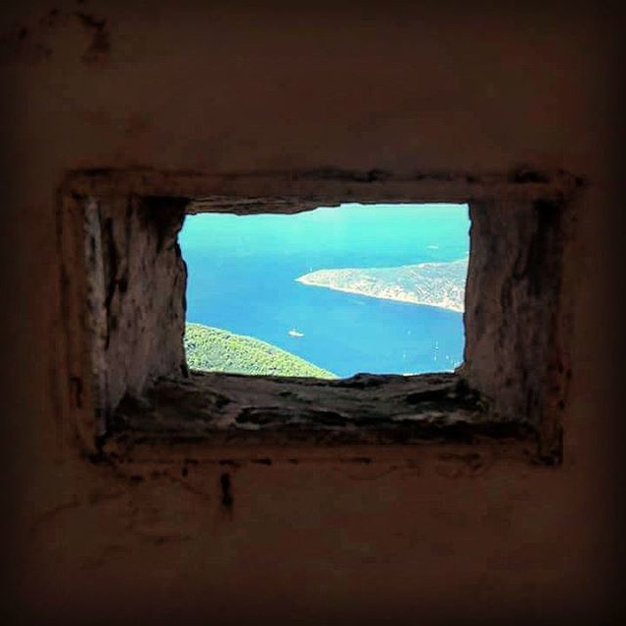 indoors, window, sea, water, architecture, built structure, abandoned, sky, damaged, horizon over water, blue, old, day, deterioration, no people, run-down, nature, house, obsolete, wall