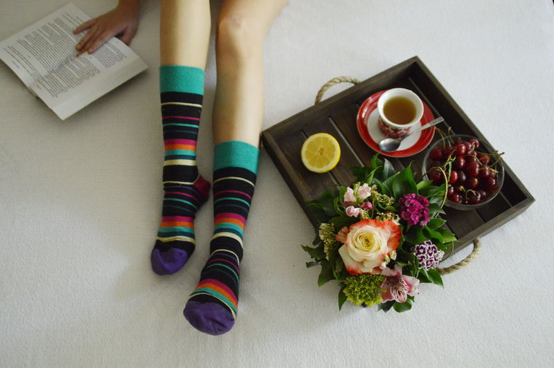 Adult Bed Book Bouquet Directly Above Drink Flower Food And Drink Freshness High Angle View Human Body Part Human Leg Indoors  Leisure Activity Lifestyles Multi Colored One Person One Woman Only People Real People Sitting Tea TeaCup