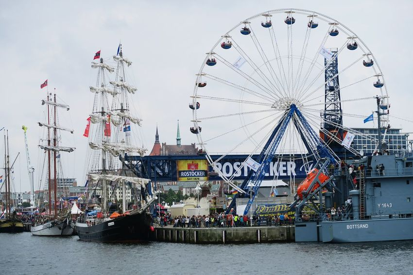 Hansesail in Warnemuende and Rostock 2016. Sailing boats from all over world meeting here for that yearly event. Amusement Park Ride Day HanseSail Hansesail 2016 Harbor Harbor View Outdoors Rostock Rostock 2016 Rostocker Hafen Rostocker Stadthafen Sailing Sailing Boat Sailing Boats Sailing Ship Sky