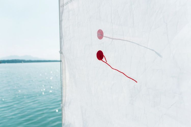 some wind... Leisure Activity Sports Activity Sailing Boat Sailing Forward Red No People White Color Day Nature Water Close-up Outdoors Sunlight Copy Space Emotion Beauty In Nature Sky