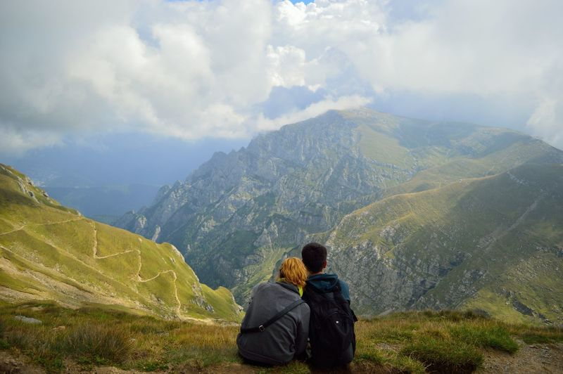 Glancing over the vale. Mountain Mountain View Hiking Rear View Scenics Tourism Tranquility Tranquil Scene Leisure Activity Travel Beauty In Nature Lifestyles Cloud - Sky Travel Destinations Vacations Sky Physical Geography Idyllic Landscape Adventure Weekend Activities Nature Majestic Carefree Ethereal