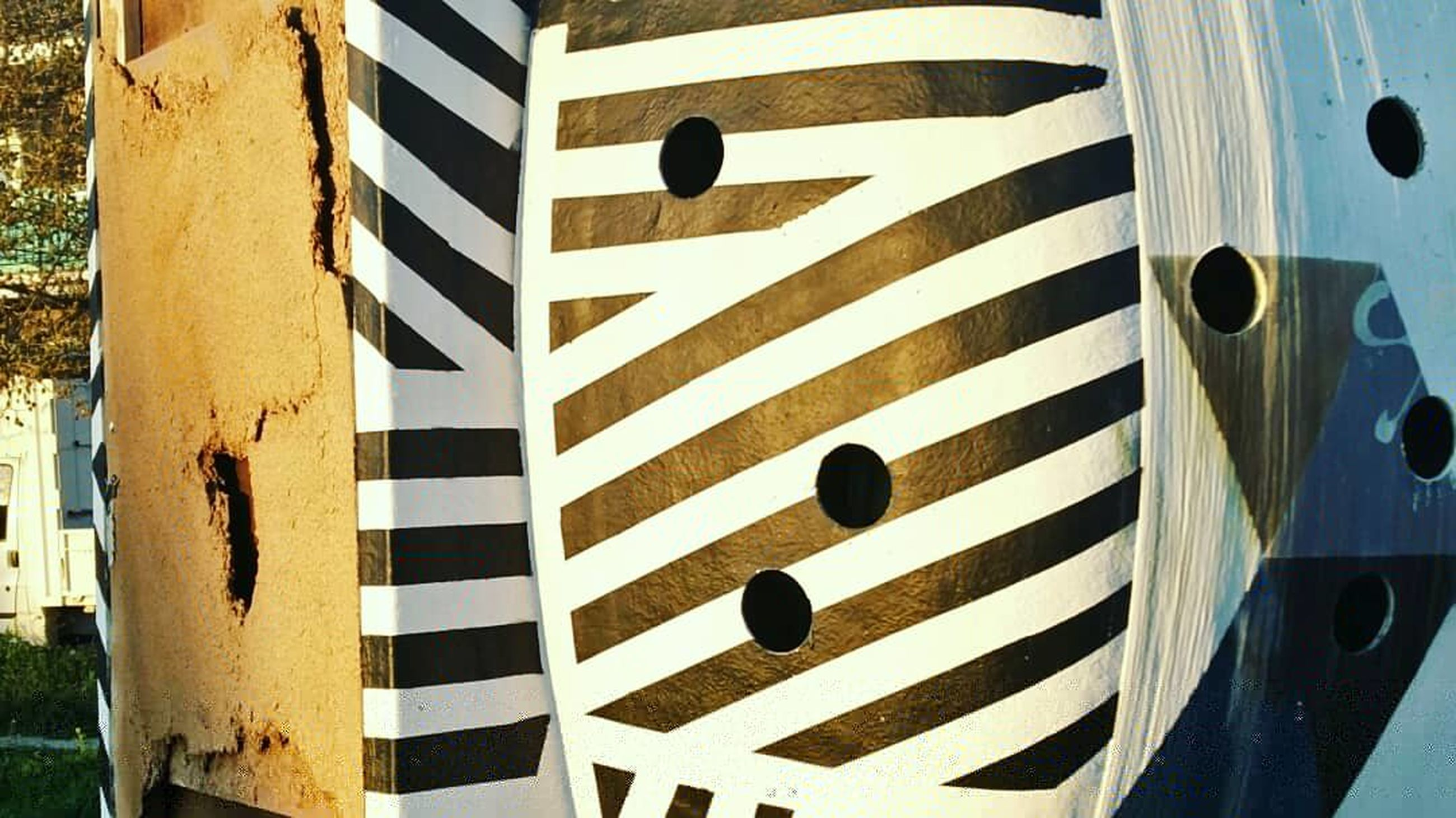 striped, no people, close-up, day, pattern, full frame, outdoors, backgrounds, black color, white color, wall - building feature, sign, shape, metal, security, communication, paint, architecture, abstract, detail