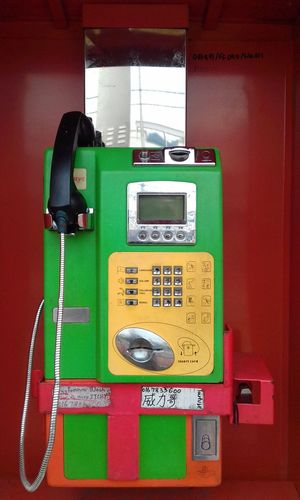Telephone Telephone Receiver Communication Pay Phone Old-fashioned Retro Styled Connection Telephone Booth Landline Phone Telecommunications Equipment Rotary Phone Technology Red Phone Cord Keypad Form Of Communication No People Close-up Headset Outdoors EyeEmNewHere The Week On EyeEm Colourful Green Color Public Phone