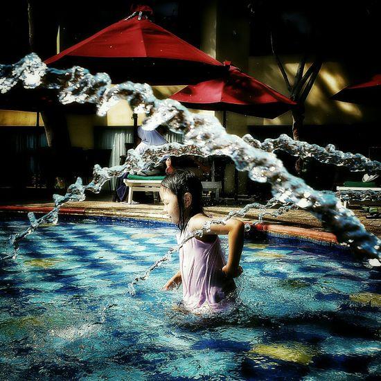 Playing with water Hello World Swimming Pool Children Enjoying Life