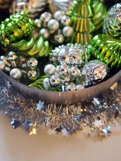 Close-up of christmas decorations in container on table