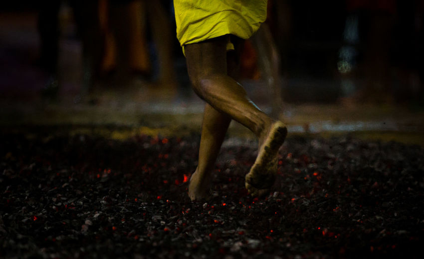 A Hindu devotee walks barefooted across the fire pit of smouldering sandalwood in the annual Firewalking Festival, also known as Thimithi, at the Sri Mariamman Temple along South Bridge Road, 12 Oct 2014. The Hindu festival, which originated from Tamil Nadu, south India, is held in honour of the goddess Draupadi Amman from the Mahabarata who, according to legend, had to walk over burning coal to prove her innocence and fidelity. Devotees now take part in the fire-walking festival to fulfil vow or to give thanks. Barefoot Barefoot Lifestyle Draupadi Amman Fire Firewalking Hindu Hindu Festival Hindu Temple India Sandalwood Tamil Tamil Nadu Temple Thimithi